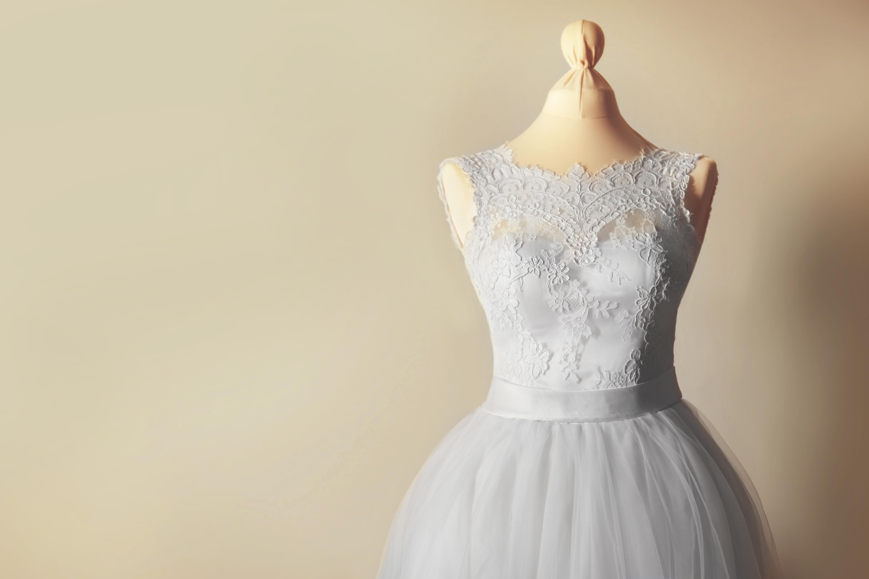 Beautiful wedding dress on wall background