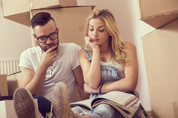 Young couple planning redecoration of their new appartment