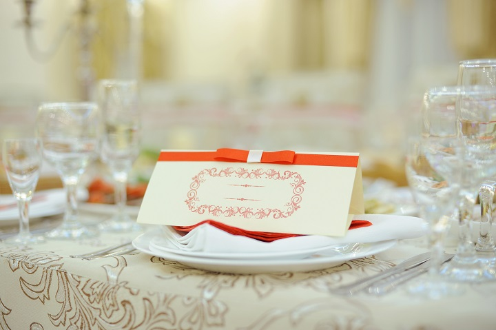 name card with red ribbon on plate